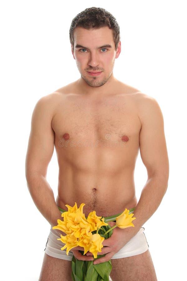 Homem 'sexy' com tulips imagens de stock royalty free