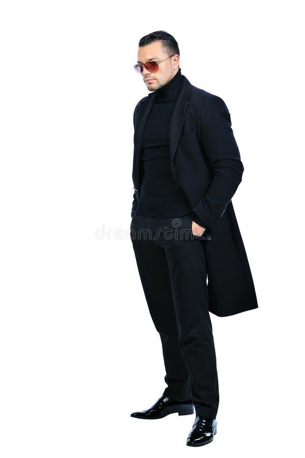 Homem 'sexy' do retrato completo do comprimento no revestimento preto isolado imagem de stock