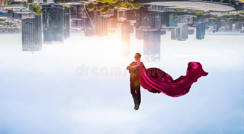 Homem super no céu foto de stock royalty free