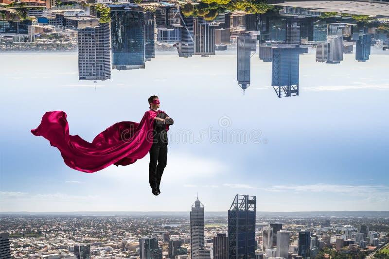 Homem super no céu fotografia de stock royalty free