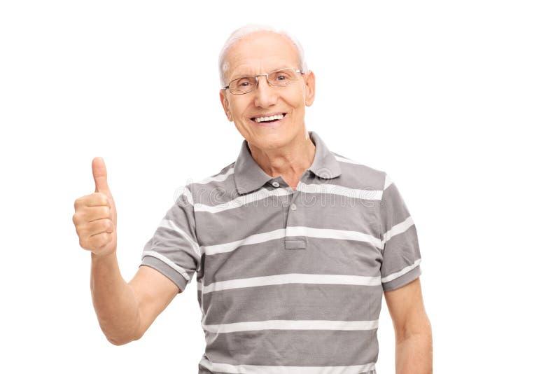 Homem superior alegre que dá um polegar acima fotografia de stock royalty free