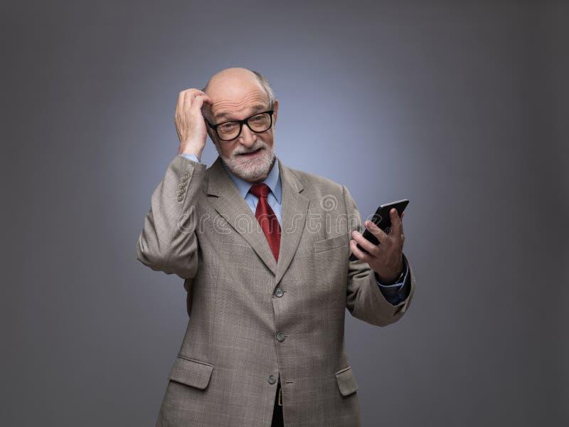 homem superior com telefone imagens de stock royalty free