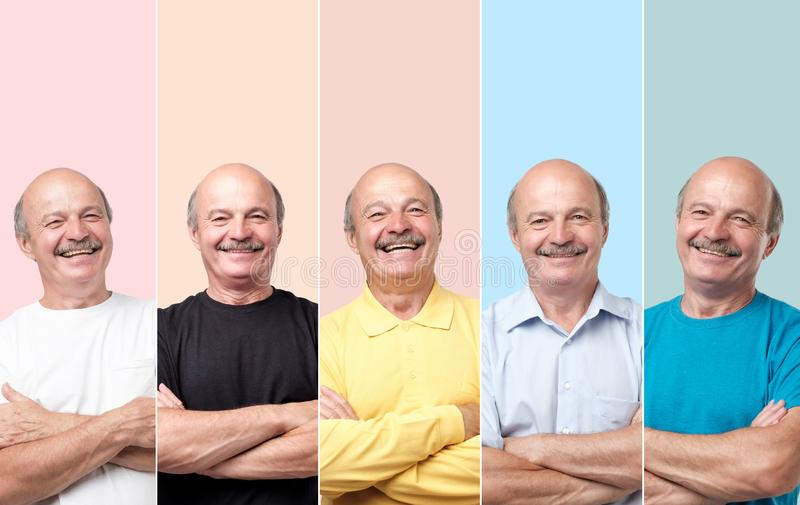 Homem superior na roupa diferente que ri e que olha com sorriso na c?mera imagem de stock