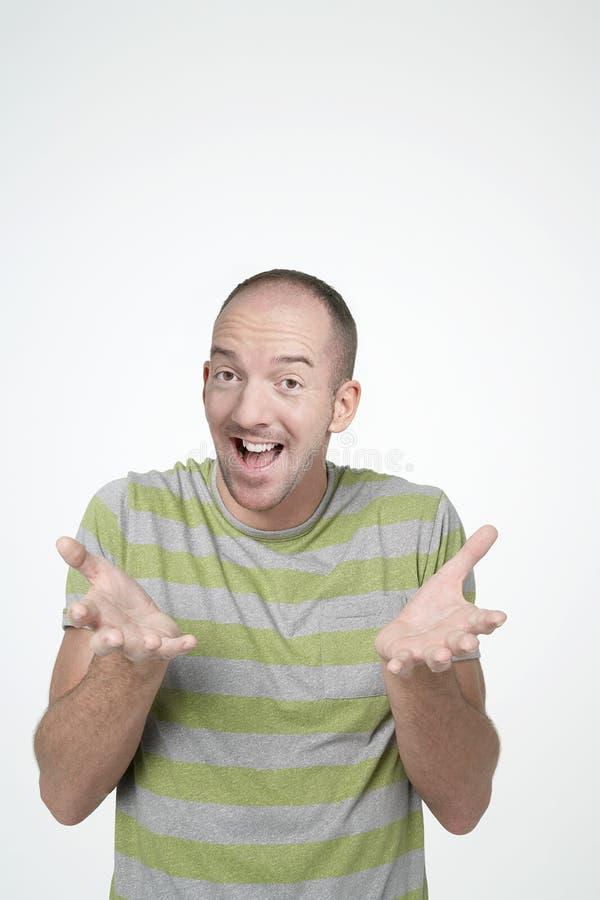 Homem surpreendido com gesto de mãos imagens de stock