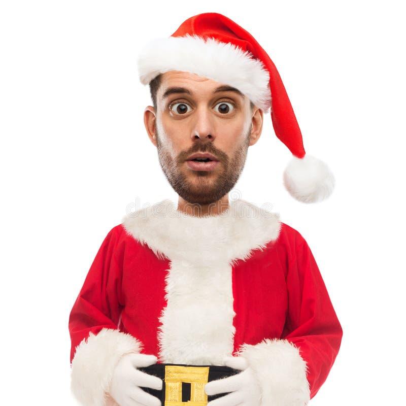 Homem surpreendido no traje de Papai Noel sobre o branco imagens de stock