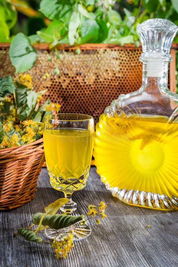 Homemade alcohol based on honey and lime royalty free stock photos