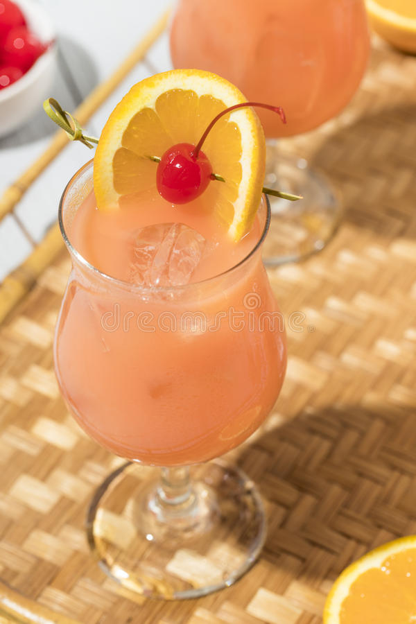 Homemade Alcoholic Hurricane Cocktail Drink. With Rum and Orange Juice stock photos