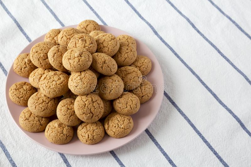 Homemade almond cookies on pink plate, low angle view. Closeup.  royalty free stock images