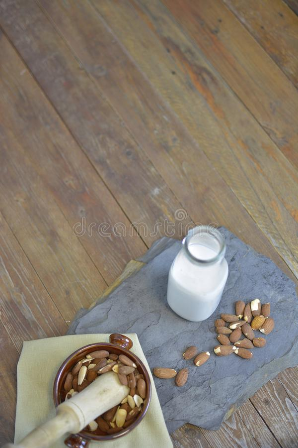 Homemade Almond milk in bottle with almonds in a bowl. Dairy alternative milk stock photography