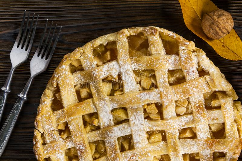 Homemade American Apple Pie Decorated with fresh apples and autumn leaves stock photos