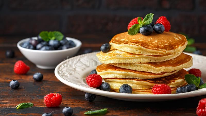 Homemade american blueberry, raspberries pancakes. Healthy morning breakfast. rustic style. royalty free stock images