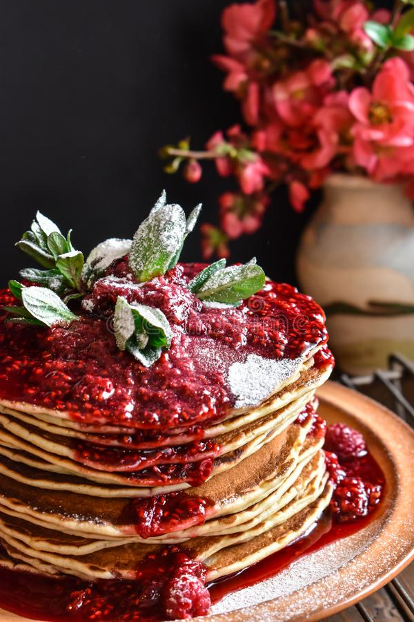 Homemade American pancakes covered with raspberry sirup stock image