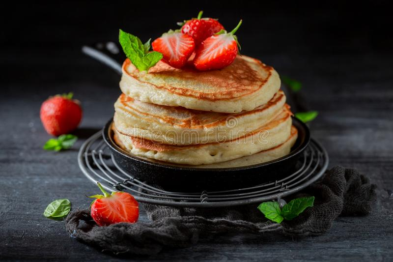 Homemade american pancakes with fresh sweet strawberries and sugar stock photos