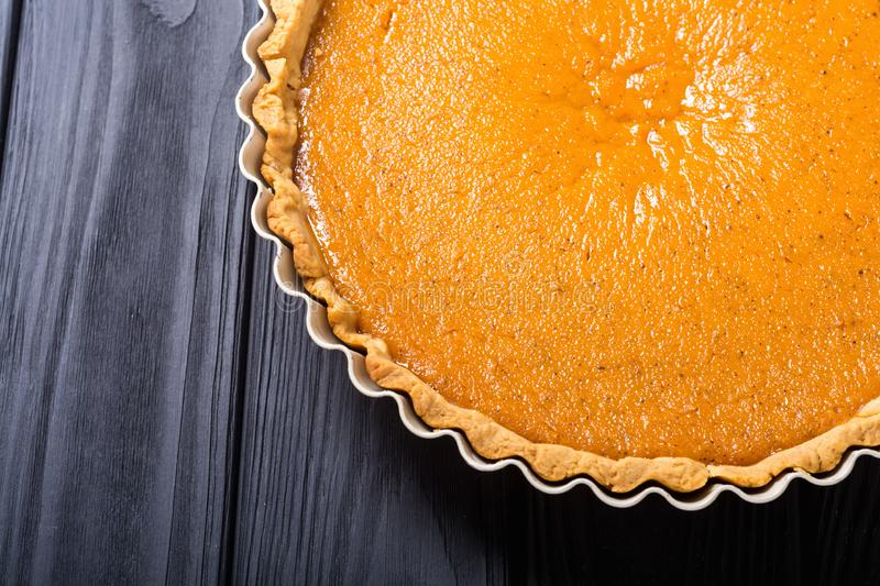 Homemade american traditional pumpkin pie Autumn food background royalty free stock photos