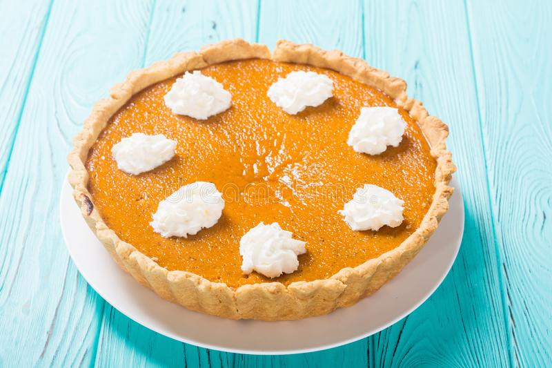 Homemade american traditional pumpkin pie Autumn food background royalty free stock images