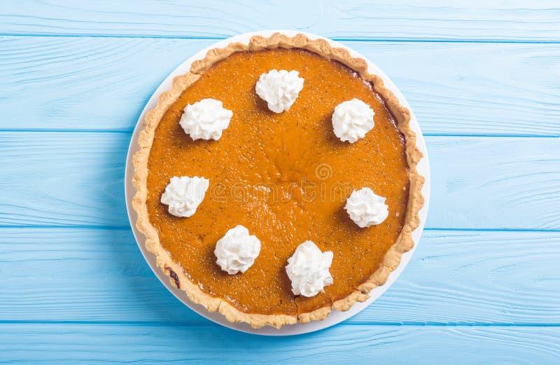Homemade american traditional pumpkin pie Autumn food background stock photos