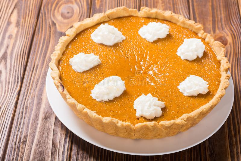 Homemade american traditional pumpkin pie Autumn food background. Homemade american traditional pumpkin pie . Autumn food background stock photography
