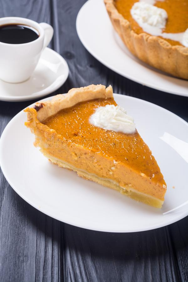 Homemade american traditional pumpkin pie . Autumn food background stock image