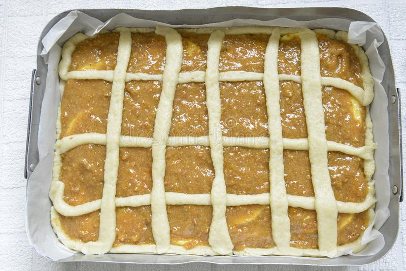 Homemade apple cake in the pan in the oven. Italian food. stock photos