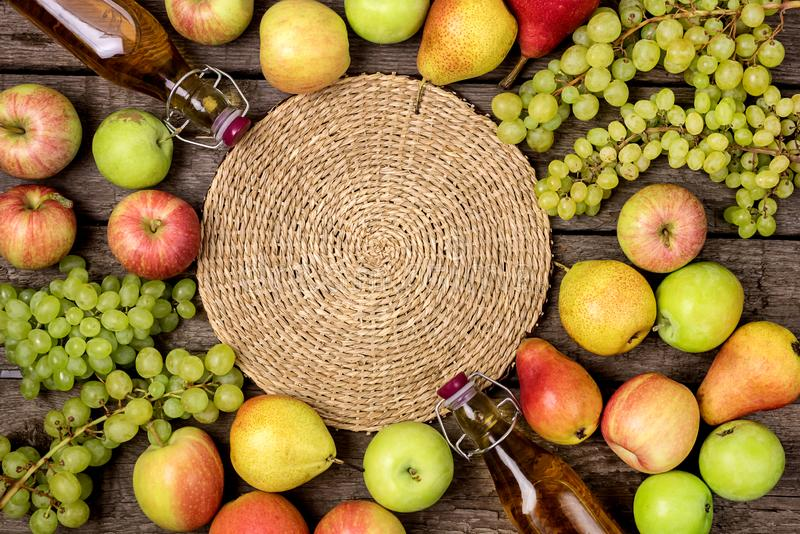 Homemade Apple Cider Vinegar Flatlay of Fresh Ripe Apples Pears and Green Grapes Two Bottles of Apple Juice or Tasty Cider Top. View Wooden Background stock photos