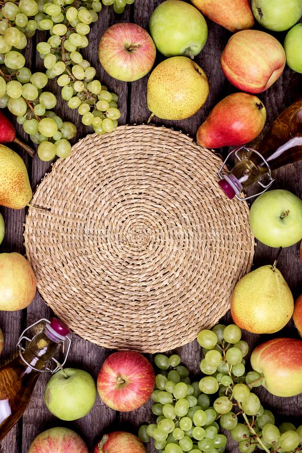 Homemade Apple Cider Vinegar Flatlay of Fresh Ripe Apples Pears and Green Grapes Two Bottles of Apple Juice or Tasty Cider Top. View Wooden Background stock image
