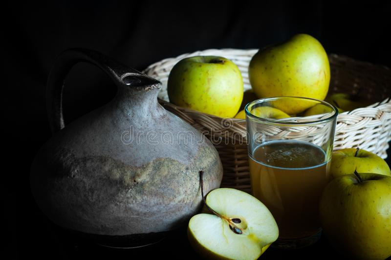 Homemade apple juice with ingredients and rustic jug royalty free stock photography
