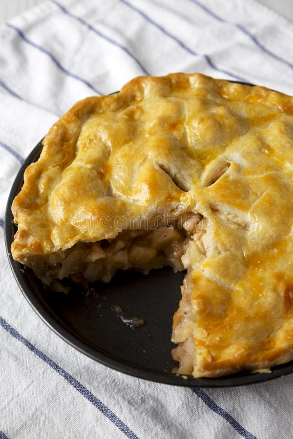 Homemade apple pie on cloth, low angle view. Closeup.  stock photography