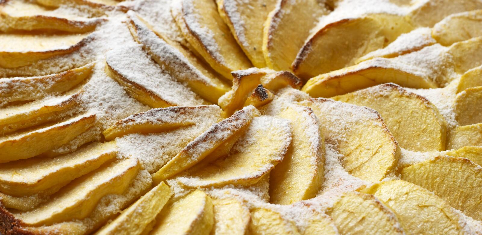 Homemade apple pie dusted with icing sugar on a white background royalty free stock photos