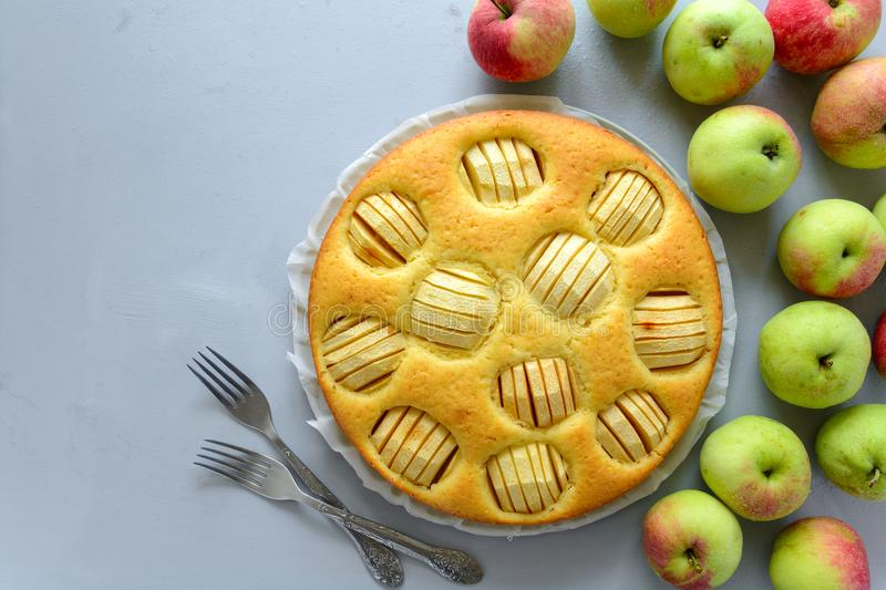 Homemade apple pie on gray wooden desk. Top view stock images