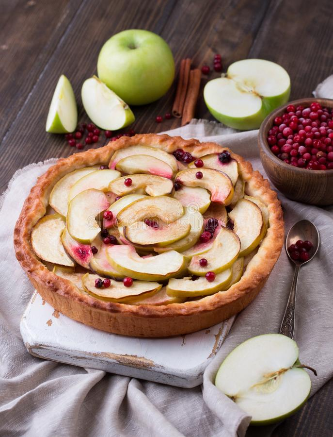 Homemade Apple Pie on rustic background. Classic autumn Thanksgiving dessert. royalty free stock image
