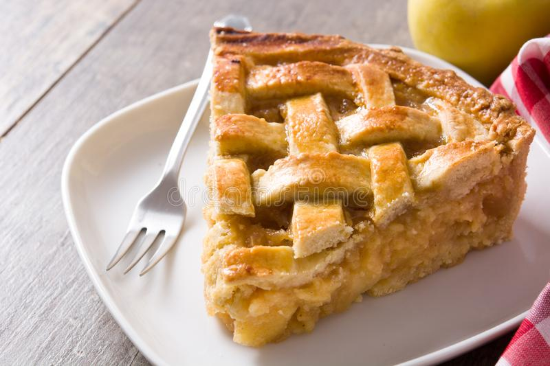 Homemade apple pie slice on wood. En table. Close up stock photo