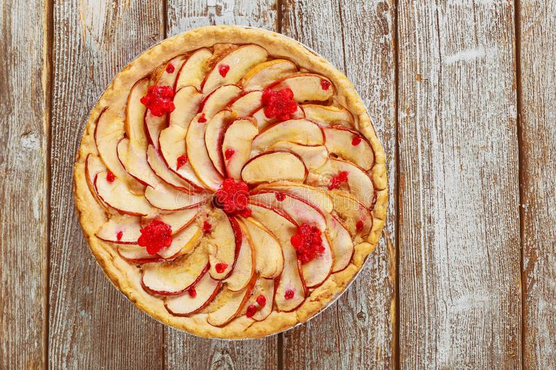 Homemade apple pie with sliced apples on the top. Ready to eat, dessert, crust, thanksgiving, bakery, cinnamon, fruit, pastry, cake, sweet, baked, fresh royalty free stock photography