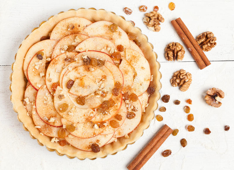 Homemade apple raw pie preparation. Tart with royalty free stock photography