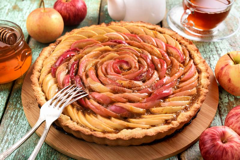 Homemade apple rose cake. Healthy delicious cake with tea, honey royalty free stock photography