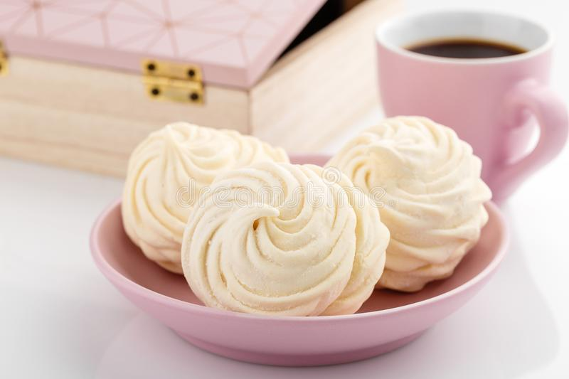 Homemade zephyr or marshmallow with coffee on white background stock images