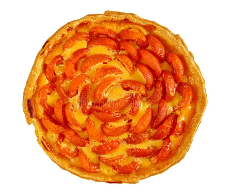 Homemade apricot tart isolated on white. Delicious homemade apricot tart with vanilla custard cream isolated on white background, view from above, close-up stock image