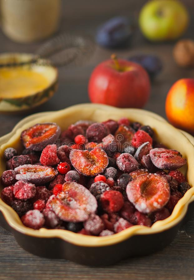 Uncooked autumn red fruit pie royalty free stock photos