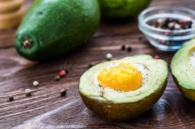 Homemade baked avocado with egg royalty free stock photo