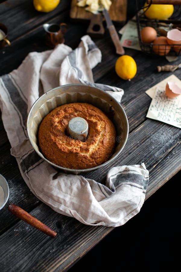 Homemade baked cake in bundt pan, process of preparation sponge lemon cake royalty free stock images