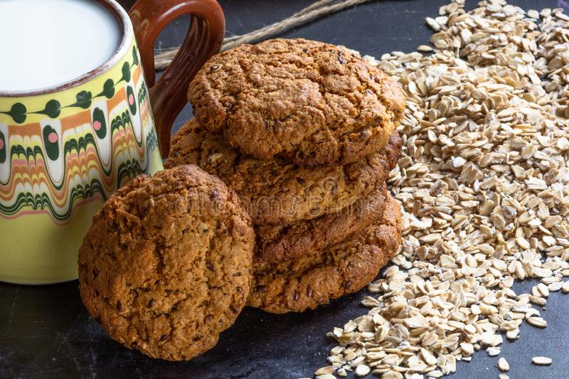 Homemade baked oatmeal cookies with linen seeds on balck background. Homemade baked oatmeal cookies with linen seeds on balck table royalty free stock photography