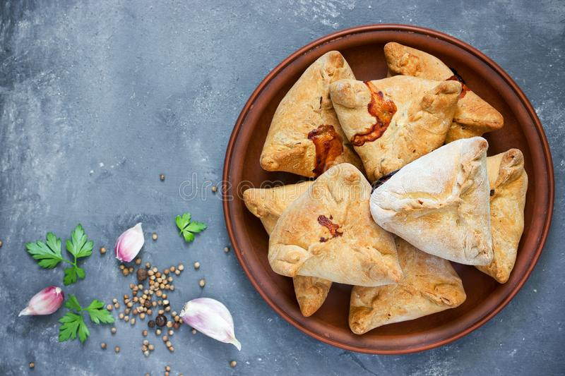Homemade baked samosas with meat stock photo