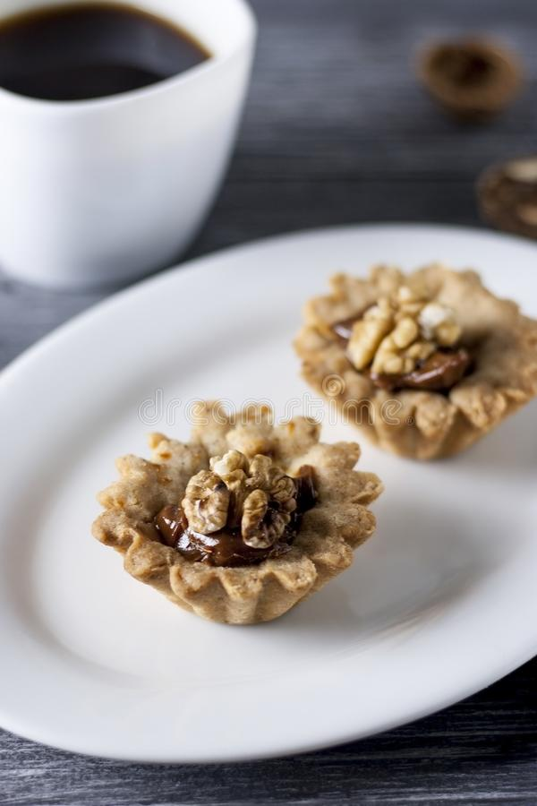 Homemade baking. Shortcake dough baskets with walnuts and condensed milk stock photography