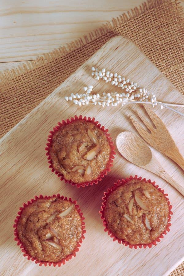 Download Homemade Banana Cupcakes On Wood Plated Stock Photo - Image: 83716513