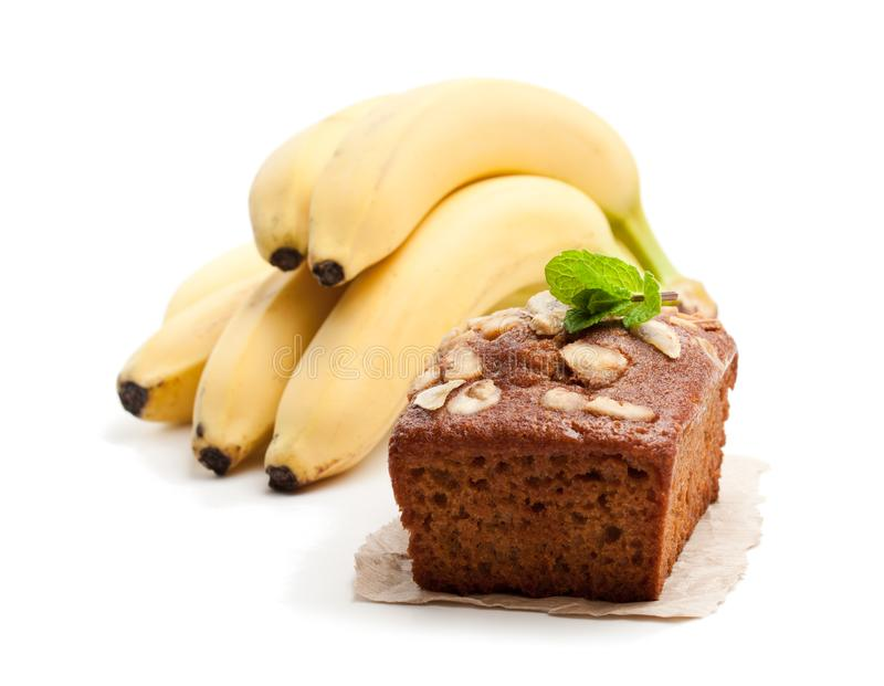Homemade banana loaf cake with fresh bananas isolated on white stock photography