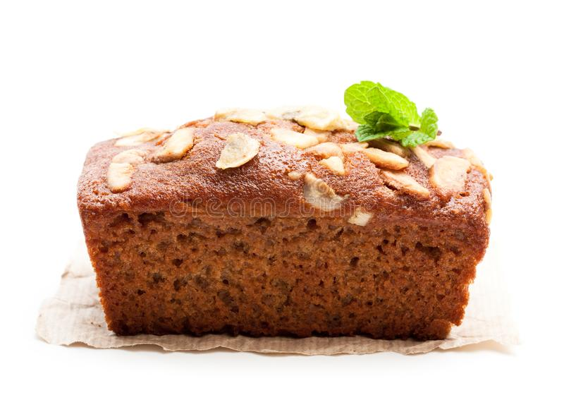 Homemade banana loaf cake with fresh bananas isolated on white royalty free stock images