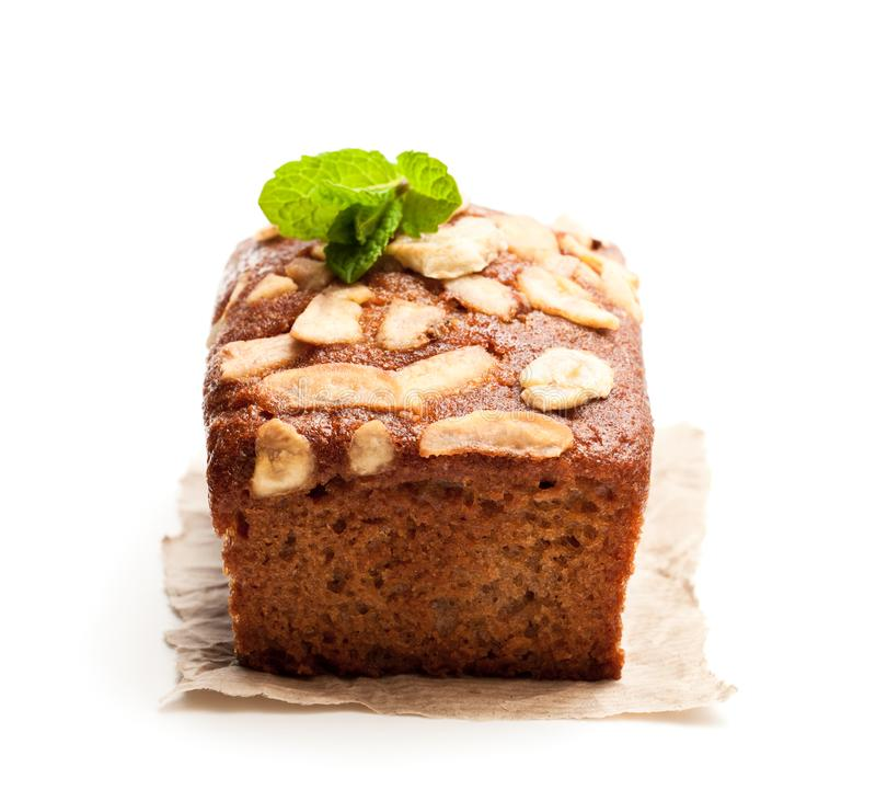 Homemade banana loaf cake with fresh bananas isolated on white stock photo
