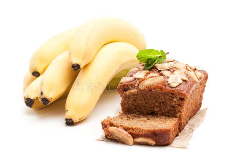 Homemade banana loaf cake with fresh bananas isolated on white stock photos