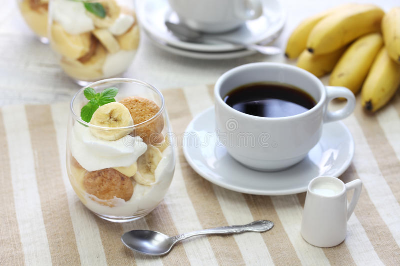 Homemade banana pudding and a cup of coffee, Southern dessert royalty free stock images