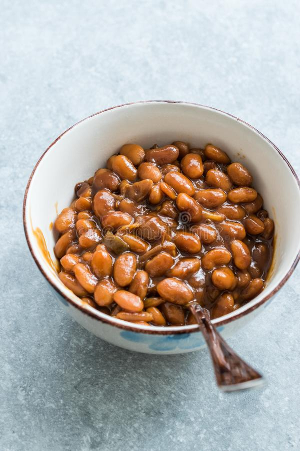 Homemade Barbecue Baked Beans in Porcelain Bowl royalty free stock photo
