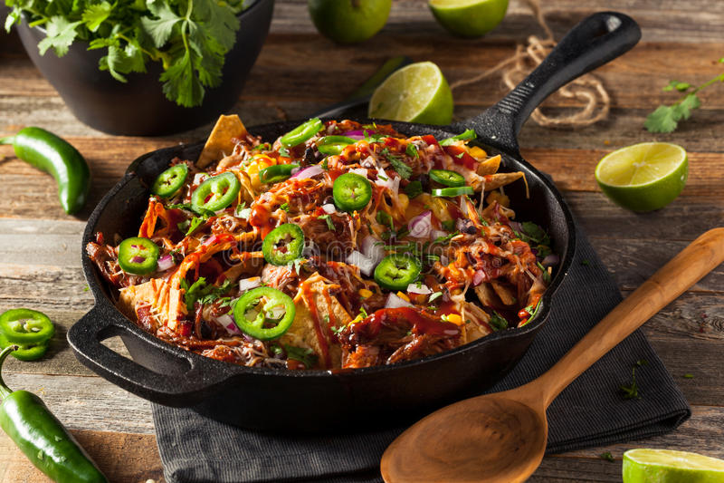 Homemade Barbecue Pulled Pork Nachos. With Cheese and Peppers stock image